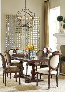 """Ballard Design's SACHA Mirror placed just off the window helps reflect even more light into this dining room!"""